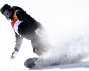 Zoi Sadowski-Synnott of New Zealand competes in the Snowboard Ladies' Slopestyle Final on day...