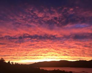 The sunrise this morning seen over Otago Harbour. Photo Alison Crossan