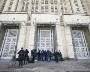 Journalists wait for the British Ambassador to Russia Laurie Bristow at the Russian Foreign...