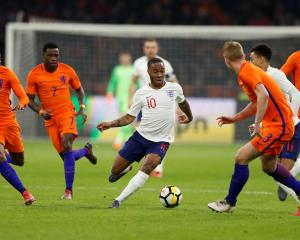 England's Raheem Sterling runs at Dutch defenders during the Three Lions' win over the...