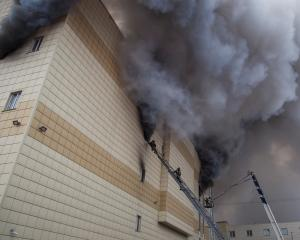 """The fire swept through the upper floors of the """"Winter Cherry"""" shopping centre where a cinema..."""