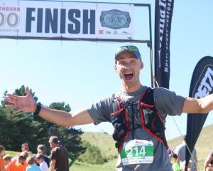 Winner of the Northburn 100 Ultra Mountain Run 50km race Laurie Harding celebrates his victory....