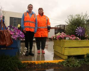 Wastebusters site manager Lauree O'Neil and shop assistant Val Joyce stand on the site of the...