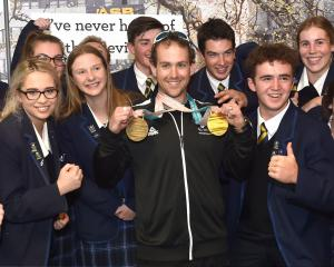 Paralympic skier Adam Hall shows his bling to Taieri College pupils. Photo: Peter McIntosh