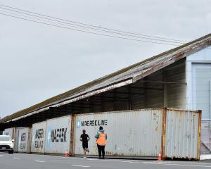 Containers block harbourside sheds in Fryatt St after the discovery of asbestos last month. Photo...
