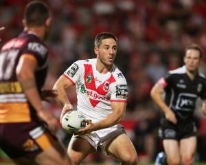 Dragons halfback Ben Hunt shapes to pass in their match against the Bronco last night. Photo:...