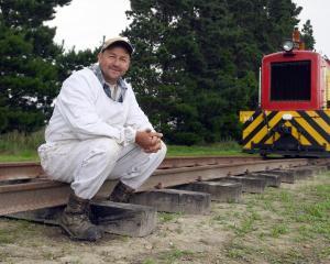 Beekeeper Blair Dale beside former New Zealand Railways Department shunting locomotive Ds201. Mr...