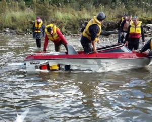 A submerged log tore through former All Black great Robbie Deans' jet boat. Photo: Wairaurahiri...