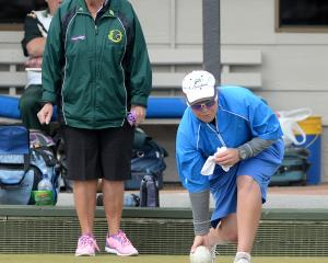 Sarah Scott, of Invercargill but representing Dunedin, delivers a bowl as opponent Margaret O...