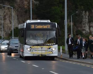 Motorists wait as a bus unloads Bayfield High School pupils on the Andersons Bay causeway last...