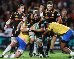 Sam Cane of the Chiefs charges forward during the round five Super Rugby match between the Chiefs...