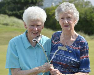 Dunedin women Reina Booth (left) and Audrey Duncan celebrate half a century of happy golfing at...
