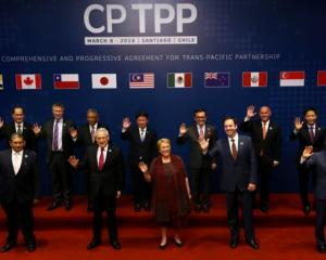 Members of Trans-Pacific Partnership trade deal pose for an official picture before the signing...