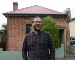 Damian Barr outside the Robert Lord cottage in Dunedin. Photos: Linda Robertson