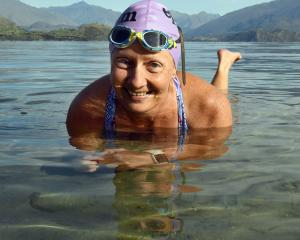 Fi Fairbairn lies in the shallows of Wanaka's Bremner Bay as she contemplates her solo swim along...