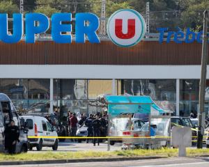 A general view shows gendarmes and police officers at a supermarket after a hostage situation in...
