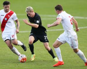 Niko Kirwan (c) in action for Team Wellington against Waitakere United during the ASB Premiership...