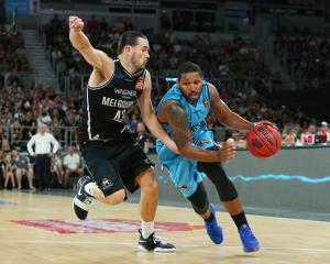 The Breakers' DJ Newbill (R) drives up court against Melbourne United. Photo: Getty