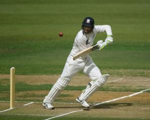 Martin Guptill picks up some runs while batting for the New Zealand XI against England in a warm...