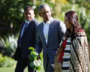 Barack Obama attended a powhiri with New Zealand Prime Minister Jacinda Ardern at Government...