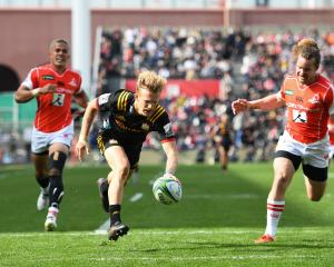 Damien Mackenzie scores in the Chiefs' 61-10 rout over the Sunwolves. Photo: Getty Images