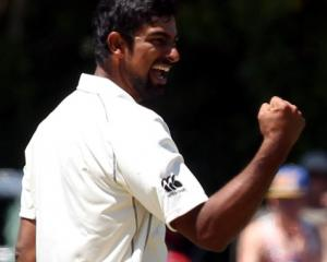 Ish Sodhi celebrates taking the wicket of Shannon Gabriel. Photo Getty
