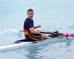 John McGlashan College's Jack McLaughlan reacts after winning the under-17 boys single sculls A...
