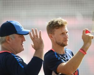 England spin coach Stuart MacGill and captain Joe Root at training. Photo: Getty Images