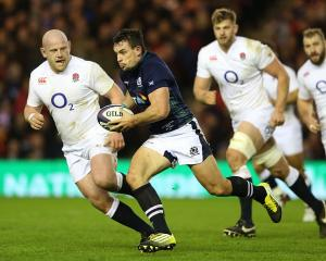 John Hardie carries the ball for Scotland against England. Photo: Getty Images