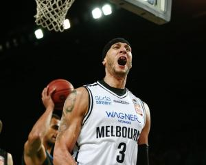 Josh Boone celebrates his match-winning basket for Melbourne United against the Breakers. Photo:...