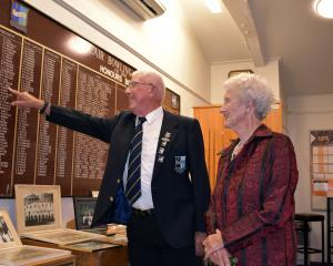 Bill Grey points to his name on the honours board while inspecting some of the memorabilia with...