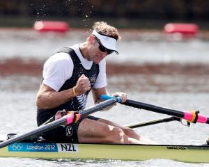 Mahe Drysdale shows his satisfaction at winning Olympic gold in the men's single sculls final....
