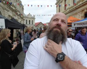 Hops on Harbour Beer Festival beard and facial hair competition judge Damian Roche, of Ipswich,...