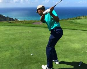Barack Obama tees off at the Kauri Cliffs golf course. Photo: Air NZ