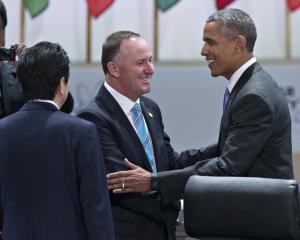Barack Obama shakes hands with John Key during a Nuclear Security Summit in 2016. Photo: Getty...