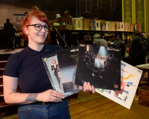 Charlotte Harraway holds tight to several Abba albums she bought at the Regent Anything But Books...