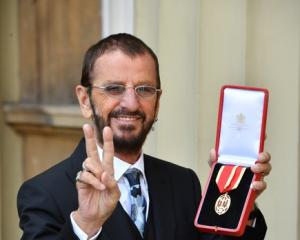 Ringo Starr, whose real name is Richard Starkey, poses after receiving his Knighthood. Photo:...