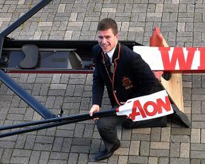 John McGlashan College's Jack McLaughlan (17) with the skiff he won at last week's Maadi Cup....