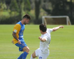 Southern United midfielder Alex Ridsdale (left) and Hamilton Wanderers' Xavier Pratt compete for...
