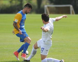 Southern United midfielder Alex Risdale (left) and Waikato's Xavier Pratt clash in the mach at...