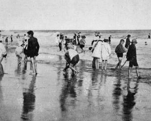 Children paddling in the surf and enjoying the health-giving ozone at St Kilda beach on Gala Day,...