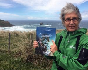 Forest & Bird Otago-Southland regional manager Sue Maturin holds the South-East Marine...