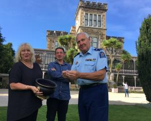 Larnach Castle marketing manager Deborah Price and executive director Norcombe Barker watch on as...