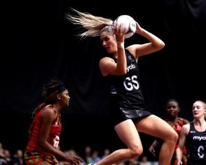Te Paea Selby-Rickit takes a pass during the Silver Ferns' win over Malawi last night. Photo:...