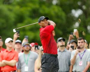 Tiger Woods plays a shot during his most recent round at the Valspar Championship. Photo: Getty...