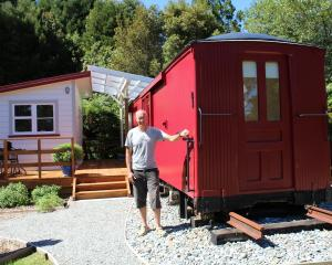 David Crook with his restored railways guards van. Photo: Greymouth Star
