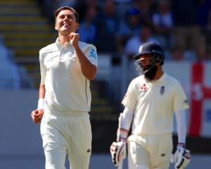 England's Moeen Ali reacts as Trent Boult celebrates after bowling England's Chris Woakes during...