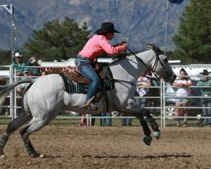 Jenny Atkinson and her horse Methven on their way to winning the New Zealand Barrel racing title...