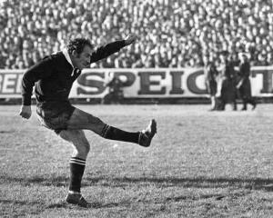 All Black fullback Fergie McCormick kicks a penalty in the first test against the Lions at...