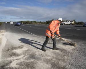 Contractors at work at the crash scene on State Highway 25. Photo: NZ Herald